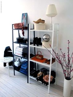 I have this shelf, but it doesn't look nearly as pretty! Great idea for decorating. Ikea lerberg shelf unit.