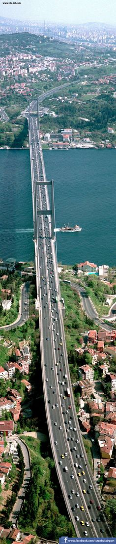 Bosphorus Bridge Istanbul. It is 1,510 m (4,954 ft) long with a deck width of 39 m (128 ft). The distance between the towers (main span) is 1,074 m (3,524 ft) and their height over road level is 105 m (344 ft). bosphorus bridg, distance, decks, the bridge, istanbul, crosses, road, bridges, place