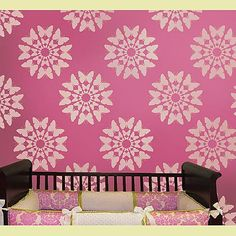 gold stencil on pink wall...nursery