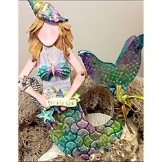 The textures jump right off this beautiful mermaid mixed media art doll created by designer Cheryl Mezzetti. See more at http://www.accucutcraft.com/mixed-media-art-doll-set.html