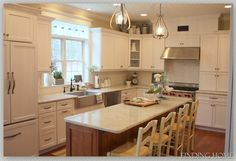Kitchen island and stainless steel farmhouse sink
