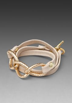 beige bracelet with gold chain links