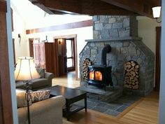 Nice wood stove hearth with cool firewood arches