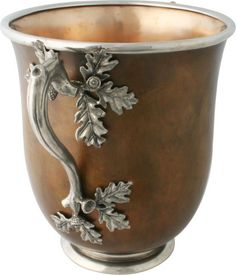 Think of the variety of uses this lovely piece could serve: ice bucket, vase, bowl. The acorn and leaf beautifully mimic nature's simple beauty.