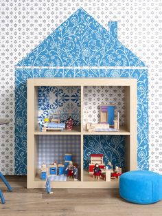 "Super cute IKEA dollhouse hack from blogger Willy Kroon! Just paint (or cut a piece of wallpaper) in the shape of a house on the wall and place a 2x2 Expedit shelf at the base. Color the inside of the ""cottage"" in coordinating colors. 