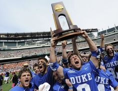 Duke's mens lacrosse team celebrating after beating Syracuse 16-10 in NCAA lacrosse final on May 27, 2013.