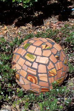 Bowling ball garden art. I used broken terra cotta pottery. bowl ball, garden art, ball garden, bowling ball