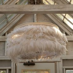 A feather & chicken wire chandelier?! Why of course I need this!