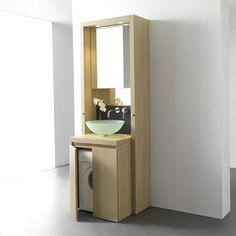 Meuble de salle de bains B1 de Kitchoo    Conçu entièrement en bois issu de forêts certifiées PEFC, ce meuble de salle de bains demeure très pratique. En haut, derrière le miroir, se cache une armoire de toilette et, en bas, une machine à laver. Il est aussi doté de deux portes serviettes télescopiques, de deux systèmes d'éclairage LED intégrés et d'une prise électrique. Pratique et esthétique, il conviendra aux plus petites salle de bains !    Dimensions : H. 260 x l. 70 x P. 63 cm.    Environ