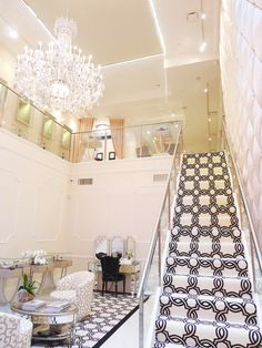 The bridal salon is decorated with a glittering Schonbek chandelier! salon and spa decorating, bridal salon decor, salon chandelier, salon owner