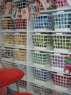I NEED this desperately!! ....fabric storage in laundry baskets ... would make it much easier to SEE what is in this huge assortment of supplies.