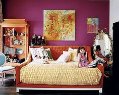 Love the sangria wall and orange velvet bed. Love that bed frame, looks so cozy
