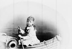 Little May in her boat.  She looked so much like her sister Alix.