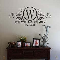 Swirly Circle Family Monogram Vinyl Wall Decal by back40life, $22.00  I got this for my living room...so excited