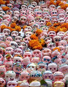 Dia de los Muertos / Day of the Dead candy skulls and traditional marigolds. #Mexico #tradition