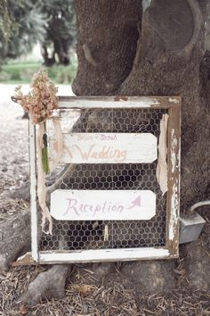 wedding sign displayed on chicken wire // photo by SaraLucero.com