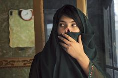 Bibi Aisha, shown here in 2010, lived in a women's shelter in Kabul for several months after her husband cut off her nose and ears. Women who flee domestic violence in Afghanistan are often imprisoned.