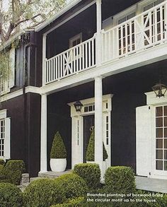 Beautiful dark house with white trim