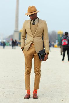 Typically we'd say something snarky about the pants being too short, but damn those socks make the outfit.