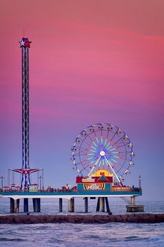Galveston Pleasure Pier at Dusk |  Amusement park on the ocean in Galveston, Texas
