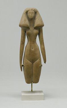 Female figure  Period: Middle Kingdom Dynasty: Dynasty 12 Date: ca. 1991–1450 B.C. Geography: Egypt, Upper Egypt; Thebes, el-Asasif, Birabi, Tomb CC 24, Carnarvon/Carter excavations 1910 Medium: Conifer (Cedar)