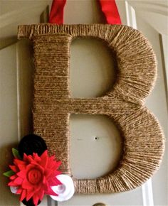 Wrap twine around craft store letter and add some embellishments. Twine Monogram Wreath with handcrafted felt flowers by rbirkel on etsy.
