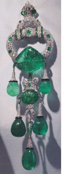 Cartier. Shoulder brooch owned by Majorie Merriweather Post. Eight inches long, set in platinum. 250 carats of carved Indian emeralds from the 17th Mughal period. Set by Cartier New York, 1928