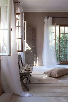Light, flowy curtains, rustic room