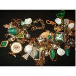 I most definitely need a charm bracelet with emeralds!