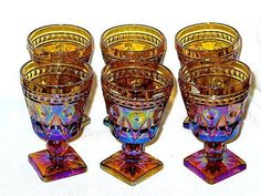 Very Rare footed wine goblets/stem glasses in amber carnival glass made by Colony Glass Co. in the Park Lane pattern during 1950's/60's. Lovely irridescent colors and square base.