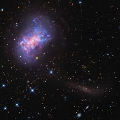 A mere 12.5 million light-years from Earth, irregular dwarf galaxy NGC 4449 lies within the confines of Canes Venatici, the constellation of the Hunting Dogs. About the size of our Milky Way's satellite galaxy the Large Magellanic Cloud, NGC 4449 is undergoing an intense episode of star formation, evidenced by its wealth of young blue star clusters, pinkish star forming regions, and obscuring dust clouds in this deep color portrait.