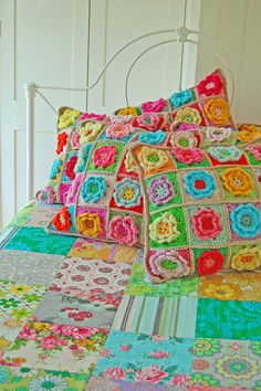 Crochet pillows and colourful patchwork bedspread