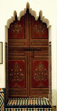 Marrakesh, Morocco.... the doors, door ways, paint door, arch, red flowers, painted doors, morocco, old doors, entrance