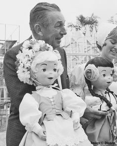 """Walt Disney """"meets"""" some residents of the 'it's a small world' attraction at Disneyland in California, during construction in May, 1966."""