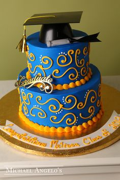 Gold Graduate #24Graduation This creation is made up of two-tiers that are iced in colored buttercream. The swirls and dots make great accents along with the graduation kit that includes the cap, diploma and Graduate sign. This cake can be changed to match any school colors.