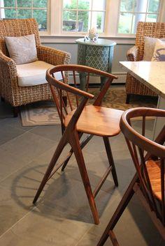 Wicker & seafoam, the perfect coastal decor combination. Kitchen design by Norton-OBrien Design