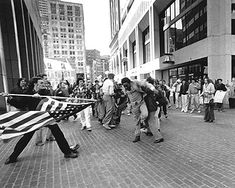 Soiling of Old Glory (Stanley Forman,1977, Pulitzer Prize Winner)  The photograph depicts a white teenager, Joseph Rakes, about to assault black lawyer and civil-rights activist Ted Landsmark with a flagpole bearing the American flag.  It was taken at Boston City Hall on April 5, 1976, during a protest against court-ordered desegregation busing.