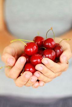 cherries in hands