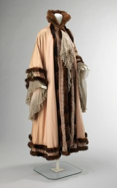 """Jacques Doucet, c. 1902.  """"This evening coat is a fine expression of the Belle Époque aesthetic of luxurious surface embellishment. The combination of fabrics, chiffon, velvet, eyelet and mink, represent the opulent taste of the period. The silhouette of the cape and the beautifully shaped sleeves would only adorn one of Doucet's finest clients."""" text from website"""
