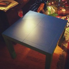 The $34 Lego table: Lack table $8 at Ikea; five base plates $5 apiece at lego.com; superglue a buck more. Lego baseplates work with Duplo blocks too, so this thing is gonna last us from now until approximately FOREVER.