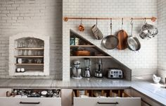 Love the copper pot rack, appliance nook, and white brick.  Bunker Hill Kitchen | Remodelista