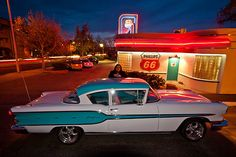The photographer and his 1958 Pontiac Chieftain at the 66 Diner on Route 66 in Albuqerque, New Mexico