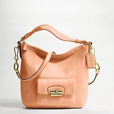 Not normally the biggest Coach fan, but this bag is classic.  Plus, the sun is shining in Providence which makes me want all things coral.