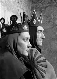 Macbeth and Lady Macbeth sitting next to each other in then play.