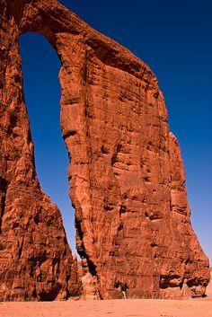 Natural arch in the Ennedi Desert, Chad - (Look out for the person at the bottom of the arch)