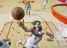 Luis Scola scores in close against the Nuggets