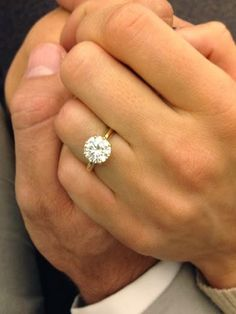 round solitaire engagement ring set in yellow gold - absolute perfection