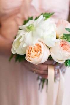 Bridesmaid Bouquet - Not sure what the large flat, really open white flower is. Love the center of it! Wedding on SMP: http://www.StyleMePretty.com/2014/05/29/providence-public-library-wedding/ Photography: RuthEileenPhotography.com - Floral Design: WildfolkStudio.com