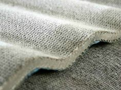 Concrete Cloth from Concrete Canvas | Designed by two engineering students in England, Concrete Cloth is a flexible, cement impregnated fabric that when hydrated hardens forming a thin, durable, water proof and fire proof material. It is supplied in 1m wide rolls, 200 sq m long and is available in 3 standard thicknesses.
