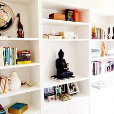 White IKEA Bookshelves With Books and Accessories